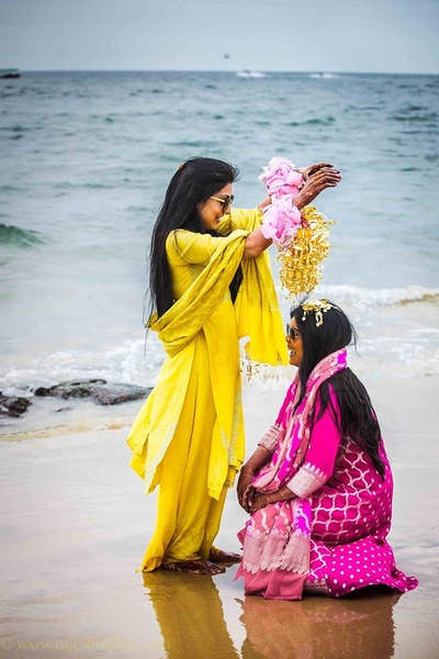 Dressed in a yellow punjabi suit for the beach side chooda ceremony held at Goa Marriott
