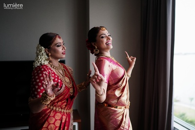 a candid capture of the bride and her sister dancing just before the wedding