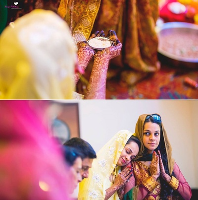 Muslin wedding traditions with arms covered with intricately patterned bridal mehendi design