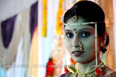 Bride wearing traditional Maharashtrian Nathni studded with pearls and gemstones