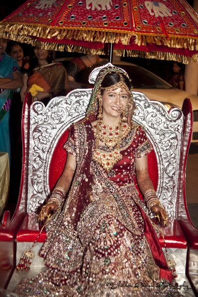 Red wedding lehenga embellished with heavy embroidery and stone work