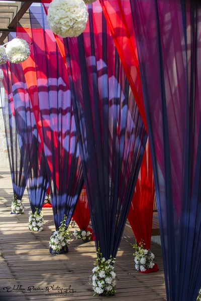 Pleated tent holders with bunch of carnations at the base