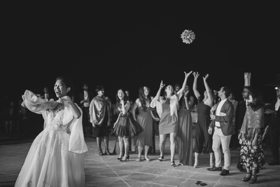 Dayoung throwing the bouquet towards her bridesmaids