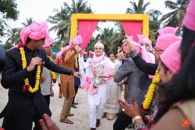 Dancing groom entering the wedding