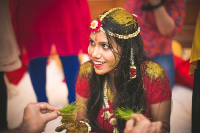 Decked in red outfit and matching fresh flower jewellery made with Jasmine buds and Rose petals