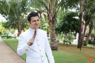 Full sleeves white sherwani worn by groom for the wedding