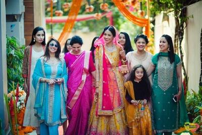 Bride and bridesmaids enter the wedding venue