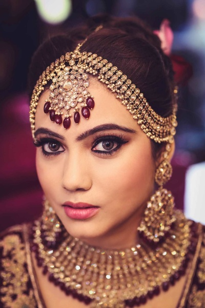 Bold eye makeup and statement bridal jewellery complete Manjot's look