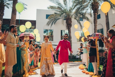 Bride and groom making a fun entry to the mehndi ceremony
