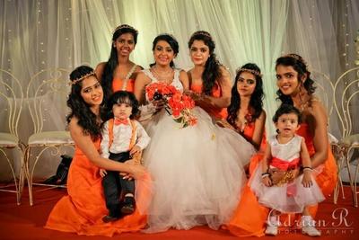 White and tangerine themed wedding decor