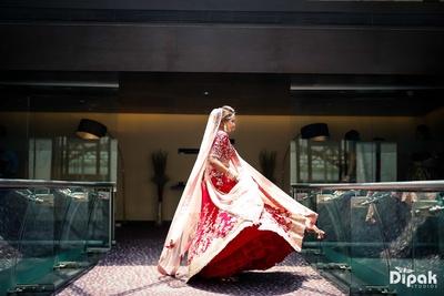 Bride twirling in her red lehenga at Sahara Star, Mumbai