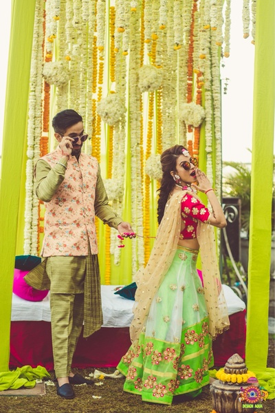 Quirky candid wedding photography of the bride and groom during the mehndi ceremony