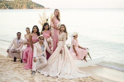 the bride with her squad at the beach