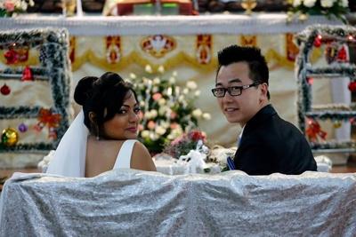 Folded bridal updo adorned with white veil