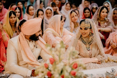 The bride and groom are all smiles during their Anand Karaj ceremony!