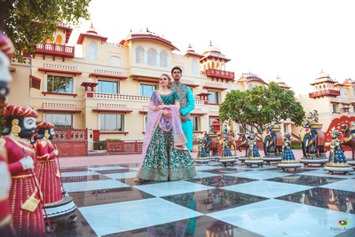 Bride and groom in matching blue lehenga and sherwani for the mehendi ceremony