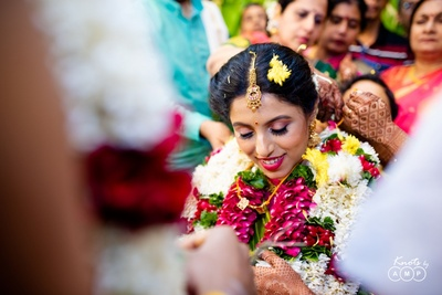 a  candid capture of the bride during the wedding ceremony