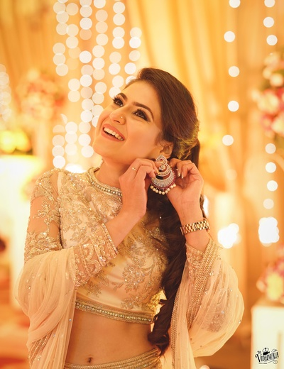Bride getting ready for her dhinchak sangeet ceremony