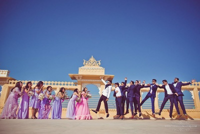 Bride and groom in a funky pre wedding photography with friends