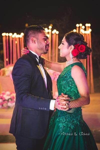 Bride and groom dance together at their sangeet function at  Taj Jai Mahal Palace, Jaipur