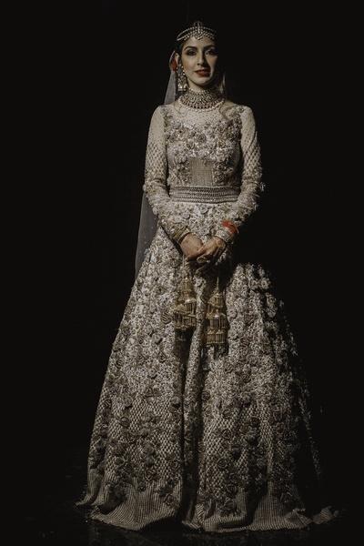 Tanya wore an ivory Nivedita Saboo lehenga for the wedding and reception.