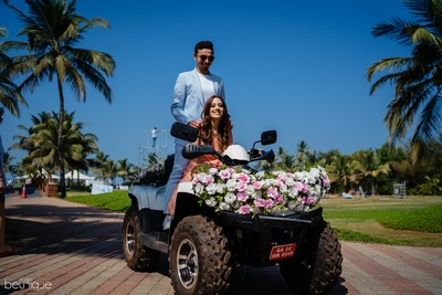 the couple entering the pool party on a quad bike