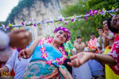 Bride queening her reign with fresh seasonal flowers and aqua beach suit