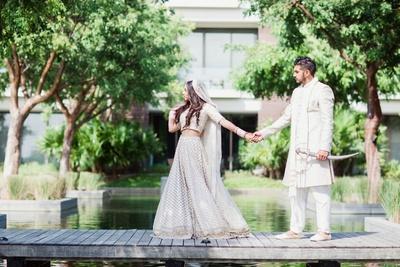 Post wedding shoot of the bride and groom in their white wedding lehenga and sherwani