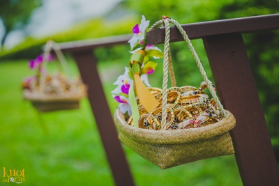 Bangles favours setup in a woven basket to be collected by the wedding guests