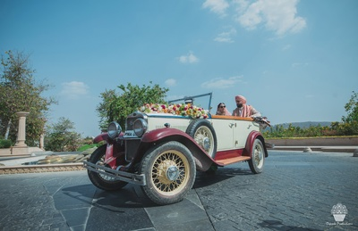Taking the bride away in a vintage car