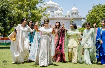 The bride and her besties having a whole lot of fun post the anand karaj ceremony.