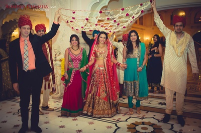 Nanki wearing Red and Gold lehenga, concept and design by Sonia Khurana and Sharon Walia and made by 'Designs by Sonia' (Sonia Khurana).