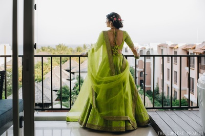 The bride is slaying it in a lime green lehengaa with beautiful latkans!