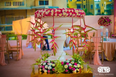 Fresh flowers on a white vase for the mehndi ceremony - decor ideas and props