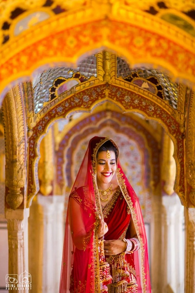 Shining bride in the glorious, ornate Chomu Palace