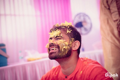 Close up capture of the traditional groom during his haldi function