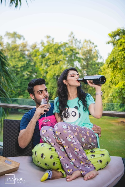 A super-cool pre-wedding shoot with the couple having wine in their pyjamas!