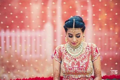 closeup bridal shot in red lehenga