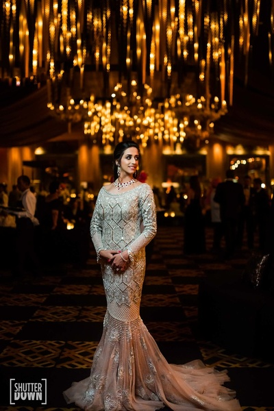 the bride in a stunning ivory gown for her cocktail party
