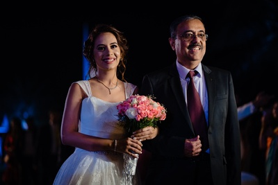the bride walking down the engagement aisle with her father