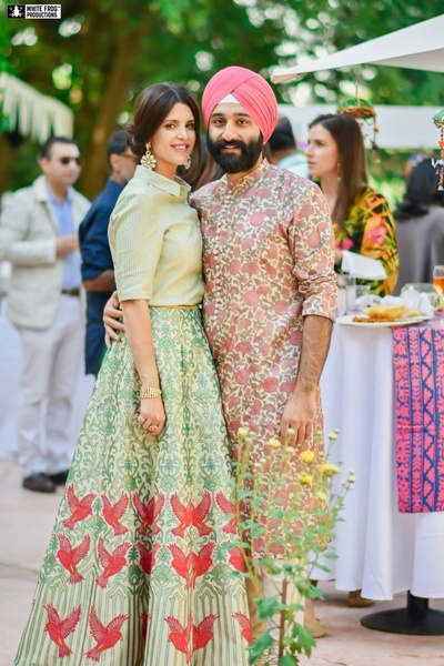 Complementing each other with floral printed mehendi outfits!