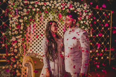 This gorgeous couple have flowers showered on them!