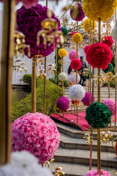 Spheres of exotic flowers used to decorate the mehendi venue.