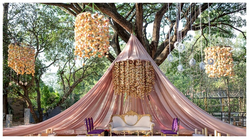 From a tent mandap with floral chandeliers to a bride in Benarasi Lehenga - this wedding was totally off-beat!