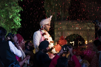 A shower of rose petals during the jaimala ceremony.