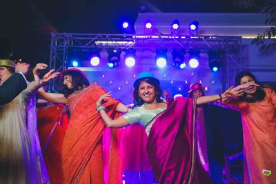 Dance performance by friends and family during the sangeet function