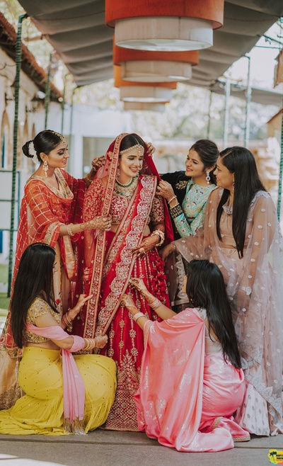 The bridesmaids helping the bride to get ready