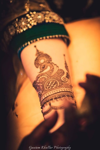 Hands covered with intricate bridal mehendi designs.