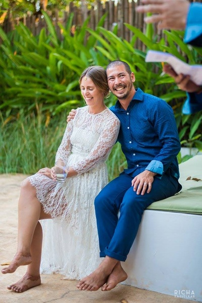 Groom dressed in a simple navy blue textured shirt, styled with matching trousers for an intimate wedding ceremony