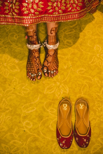 A look at her payals and toe rings.